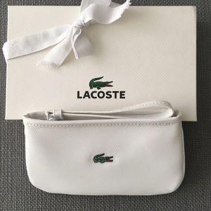 Brand new classic white Lacoste wristlet